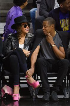 We love Beyoncé's court side style! The singer always looks *oh* so chic.  To add a pop of color (and major height) to her monochrome outfit, she stepped out in suede baby-pink platform heels.