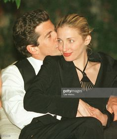 John F. Kennedy, Jr. Editor Of George Magazine, Gives His Wife Carolyn A Kiss On The Cheek During The Annual White House Correspondents Dinner May 1, 1999 In Washington, Dc.