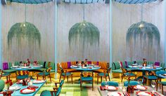 conceived by taller KEN, madero café's vibrant interior is layered with textures and colors, forming an oasis-like escape from the outside world.