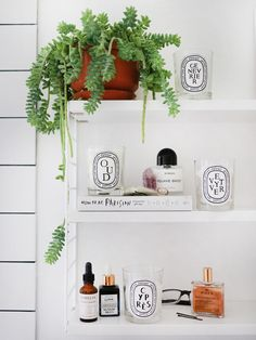 White bathroom, Diptyque candles and a string pocket shelf