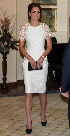 Duchess Kate chose an elegant white Lela Rose cocktail dress for the occasion, pairing it with black court heels and diamond drop earrings, as she attend a reception at Government House in Canberra, Australia, 24.04.14