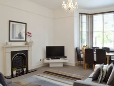 This lovely ground floor apartment is ideally located in Wimbledon Village, perfect for exploring the many delights of the bustling city of London.