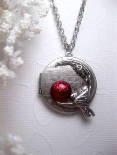 Moon Goddess Locket With Shimmer Bright Maroon - Girl On Moon Necklace - Crescent by FashionCrashJewelry on Etsy https://www.etsy.com/listing/196474013/moon-goddess-locket-with-shimmer-bright