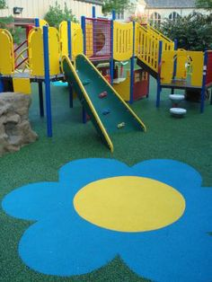"Want to add some pizzazz to your playground? How about some ""flower power""! No Fault can add pretty, colorful designs to your playground by providing our No Fault Safety Surface (poured-in-place rubber surface). It comes in an attractive array of colors. Let our in-house designer create a new, unique playground just for you!  www.nofault.com"