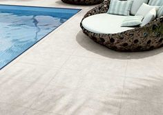 #Porcelain, as utilised in this #pool surround, is beautiful, durable and easy to maintain. #UnionTiles
