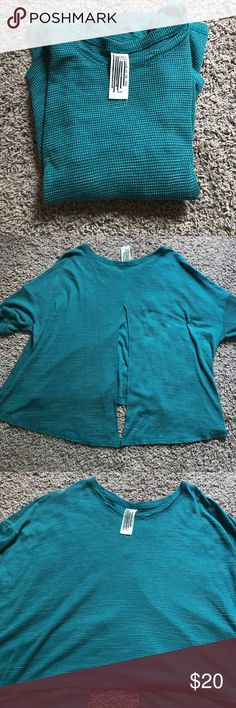 Free People High-low thermal Raw edged free People thermal shirt with open back (half way). A beautiful teal color. In great condition and only worn a handful of times. Very flowy and perfect for layering! Free People Tops