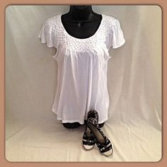 DRESSY TEE  White cotton with basket weave along the neckline. Cap sleeves. Perfect anytime of year. Casual or dress it up. Size S Elle Tops