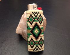 This removable Bic Lighter Cover was made with Delica beads. This cover took over 2000 beads each bead individually sewn using the peyote stitch. If