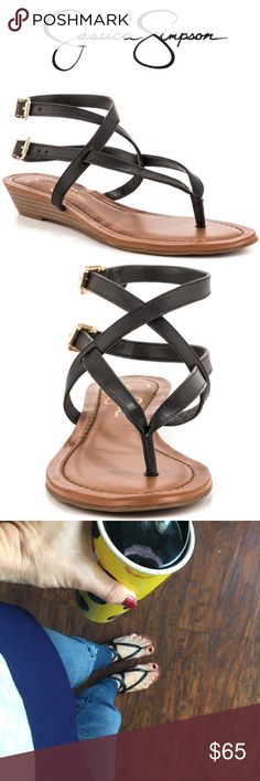 Jessica Simpson Leather Strappy Sandal Low Wedge Get your casual glamour on with this Jessica Simpson wedge sandal. Or simply lie around and enjoy lazy days! • This strappy women's thong sandal has black leather straps. • Footbed features some padding for comfort and a low 1 inch wedge delivers a slight boost. • Leather Upper • Man Made Sole • Fits True To Size • Style Name = Liliane • EUC I can't remember ever wearing them • I just recently threw out the box and the shoes don't have a size…