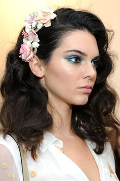 Not those flowers but I like this curly soft look with something swept up on the side.