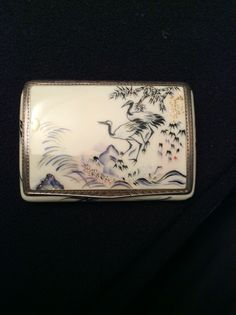 Art Nouveau cigarette case by Louis Kuppenheim. Enameled all over, front and backside decorated with birds and garden in Japanese style.