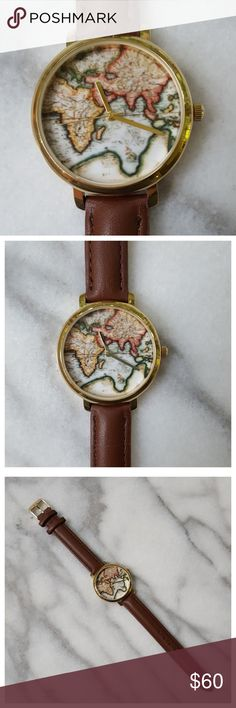 """Around the World Watch Round face features vintage world map. Gold-tone case with stainless steel back and brown leather band. Case width 1.25"""", band length 9"""", fits wrists approx 5.5"""" - 7.75"""". Urban Outfitters Accessories Watches"""