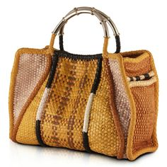 Madagascar B Large Woven Leather Tote  Ah yes, the reason I live and breathe to visit the Perez Sanz shop in Buenos Aires is quite simply because of this bag. Each piece is hand woven to perfection, this one even has a pocket in front for your cell phone or keys that is hidden as part of the design. There is not an angle of this purse you want to miss. Please look at other color options or designs in this bag if you'd like something to be woven to your specification… Alpaca is a metal