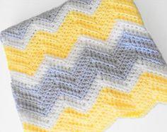 Crochet chevron baby blanket in yellow, white and light grey