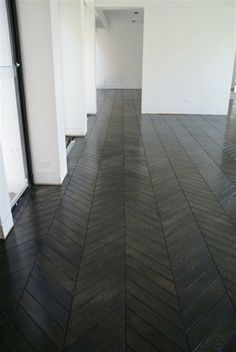 chevron floors...  Wonder if there's a concrete stamp you could get this effect with.