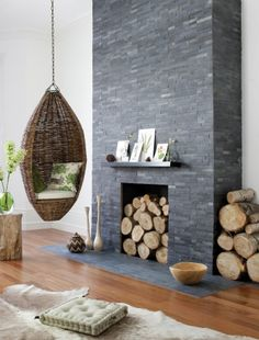 This is a beautiful faux fireplace in navy ledger stone! Get your stone tile in stock today at Builders Surplus for a fraction of the price! Builderssurplus.us