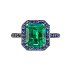 Manuel Bouvier Emerald Ring with Sapphire Surround