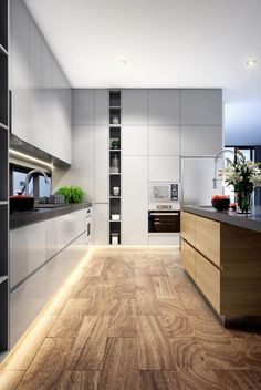 Modern and stylish kitchen design with clean white cabinets and a wooden kitchen island and dark counter top Interior Design Kitchen, Home Decor Kitchen, Kitchen, Modern Kitchen, Kitchen Remodel, Kitchen Renovation, Stylish Kitchen, Best Kitchen Designs, Contemporary Kitchen