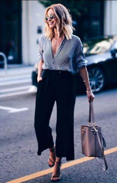 Grey striped blouse+black cropped pants+black ankle strap heeld sandals+nude bucket shoulder bag+sunglasses. Late Summer Workwear/ Business Casual Outfit 2017