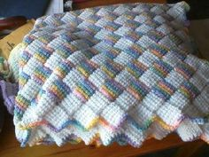 This is a Tunisian Crochet Entrelac Style Baby Blanket made from soft acrylic yarn. It measures approx 47 x 36. Its colors are White...