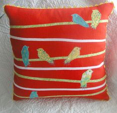 https://flic.kr/p/82A8WK | birds on a wire in brights | another version of my birds on a wire pillow.  this one in bright orange with a rick rac edging in the seams.  I couldn't stop with just one!  I have four tops together .  I will post each one and see which one wins!