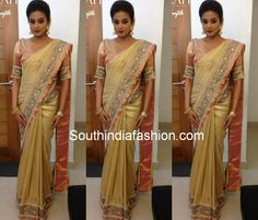 Actress Priyamani in gold color brocade embellished saree teamed up with pale pink elbow length sleeves designer blouse by Poornima Indrajith.