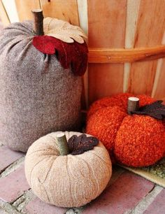 10 ideas for outdoor DIY pumpkins - this one would be great with thrift store sweaters!