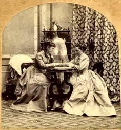Young Ladies play Ouija Board. c. 1875