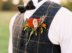 groom in plaid wool vest and matching bow tie @myweddingdotcom