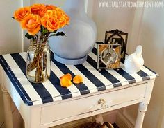 Navy Blue Stripe painted side table: http://www.completely-coastal.com/2015/09/navy-blue-and-white-living-room.html