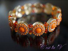 Indian Sunset gold stretch bracelet.  Indian-inspired jewelry. Includes orange gems and Swarovski crystals $40    Website: http://cestlavjewelry.com/ Etsy Store: https://www.etsy.com/ca/shop/cestlavjewelry?ref=hdr_shop_menu
