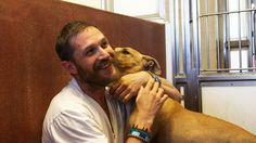 When he wasn't just walking round looking perfect, he spent a lot of 2015 talking about and cuddling dogs. It was almost enough to make your heart explode. | 29 Times Tom Hardy Was Goddamn Human Perfection In 2015