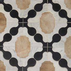 Perfect harmony of calcatta, french terracotta & noire limestone.