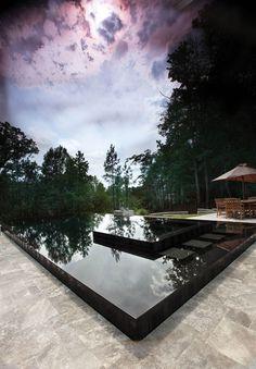 black tile perimeter-overflow pool - Selective Designs