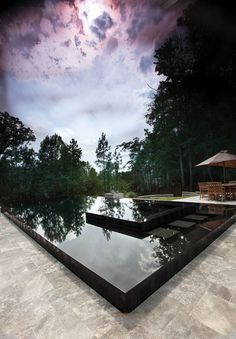 black tile perimeter-overflow pool - Selective Designs