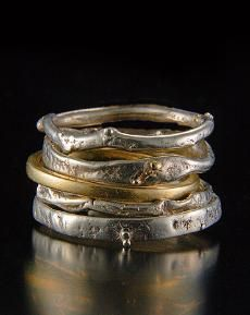 Sweet and simple fused silver stacker rings mixed with 14kt gold hammered thin bands. $45 - $175