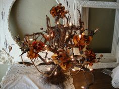 Elegant Fall Lighted Tree grapevine twig tree with antiqued bead garland autumn florals hydrangeas lighted spooky tree. $35.00, via Etsy.