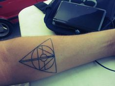 Tattoo: Deathly Hollows made from a pokeball, the triforce, and a lightsaber O.O