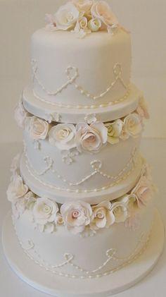 White ivory rose wedding cake bt the fantastical TooGoodToEat.co.uk