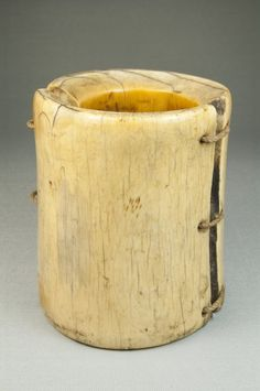 Africa |  Ivory and fiber bracelet.  Made in the DR Congo, prior to 1922. |  A large ivory bracelet made of two pieces of ivory joined by leather thongs along its vertical sides.