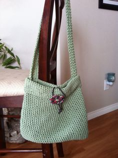 Crochet purse with polymer button/ leather thong closure.  Etsy Northern bead factory
