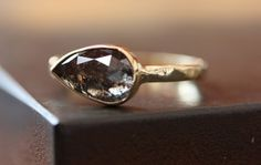 I love the idea that this is the shape the stone was found and they just made it work on the ring.