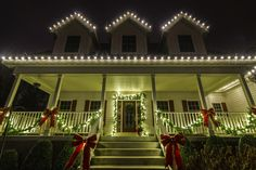 Garland, bows, and Holiday Christmas lights. Come home to the cheerful wonder of the season! Outdoor Christmas Garland, Christmas House Lights, Christmas Holidays, Favorite Holiday, Lighthouse, Stairs, Bows, Christmas Fairy Lights, Christmas Vacation