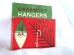 This vintage , empty Doubl Glo ornament hangers box has great graphics! With a stylized Santa and a skeleton pine branch, the size of the actual