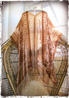Inspired by 70's boho babes and rock n' roll Goddesses! Incredible Baroque pattern burnout velvet with fishnet fringe all along bottom.  Hand dyed in a stunning apricot color for a real vintage vibe.  Super easy to wear style that goes great with anything and everything year round, truly a timeless and effortless piece! Also available in Ivory shown in last picOne size fits all Rayon velvet burnout100% silk fringeDry clean or Hand Wash Line dryThe velvet burnou...