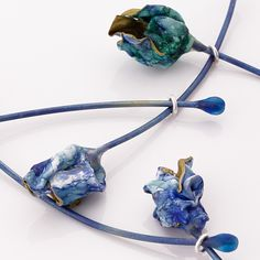 Flower Bud - Detail from Blue Rot Necklace by Mirela Tufan (Titanium, Sterling Silver, Ink and Plastic)