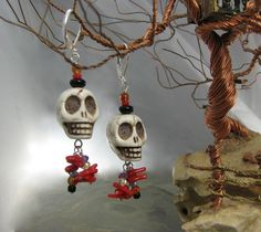 Fun!  Skulls, two heads are better than one!  Sterling silver leverback earrings for your haunting nights (and days).