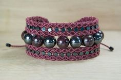 micro macrame bracelet with hematite and garnet stones, handmade with waxed threads