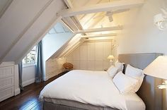 I love this as a guest room! <--me too! the vaulted ceiling and slant add a roomy but cozy feel.