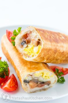 These breakfast burritos will make a breakfast person out of you. Crisp on the outside and filled with egg, ham and cheese. Freezer friendly breakfast burritos!